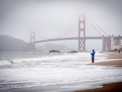 A Man Casting His Line Not Far From the Golden Gate Bridge in San Francisco Image by Michael Bracey